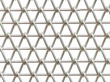 A piece of stainless steel conveyor belt mesh on the white background.