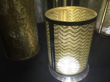 A fine woven mesh is covering the lamp.
